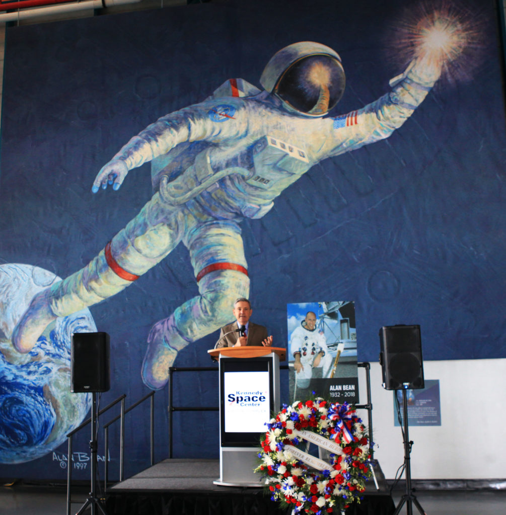 A large mural of a painting by Alan Bean