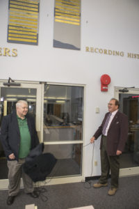 "Craig Covault, left, and George Diller unveil their names on the ""Chroniclers wall"" during a gathering of the honorees' friends, family, media, and current and former NASA officials at Kennedy Space Center's NASA News Center in Florida on Friday, May 4."