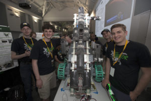 "Team Raptor members from the University of North Dakota College of Engineering and Mines check their robot, named ""Marsbot,"" in the RoboPit on May 23, 2017, at NASA's 8th Annual Robotic Mining Competition at the Kennedy Space Center Visitor Complex in Florida."