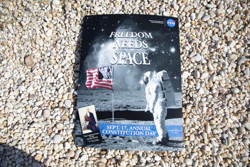 "The Kennedy Space Center ""Freedom Needs Space"" poster is in view at the new Headquarters Campus Building."