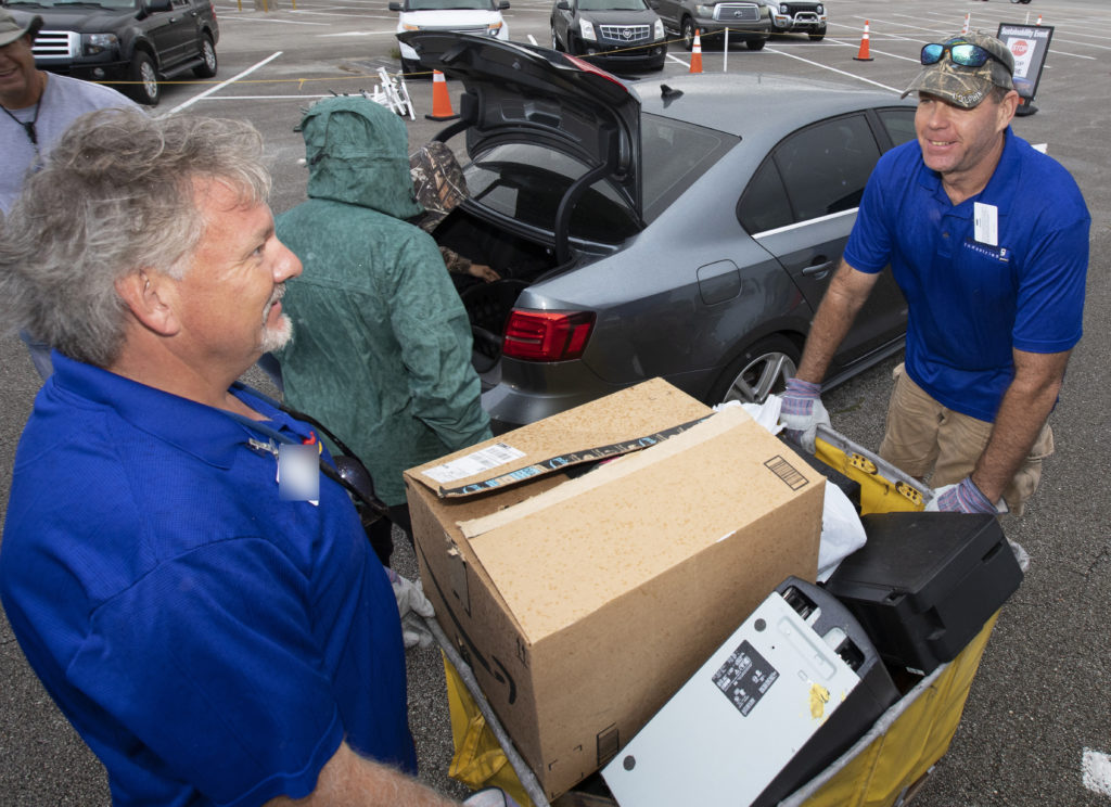 In the parking lot of the Data Center at NASA's Kennedy Space Center on Nov. 15, 2018, employees turn in used household material for recycling as part of America Recycles Day. The annual event is a nationally recognized initiative dedicated to promoting recycling in the United States. This year, KSC is partnered with Goodwill Industries and several other local organizations to receive donation material from employees such as gently used household items, personal electronic waste, greeting cards and serviceable eyeglasses. Photo credit: NASA/Kim Shiflett