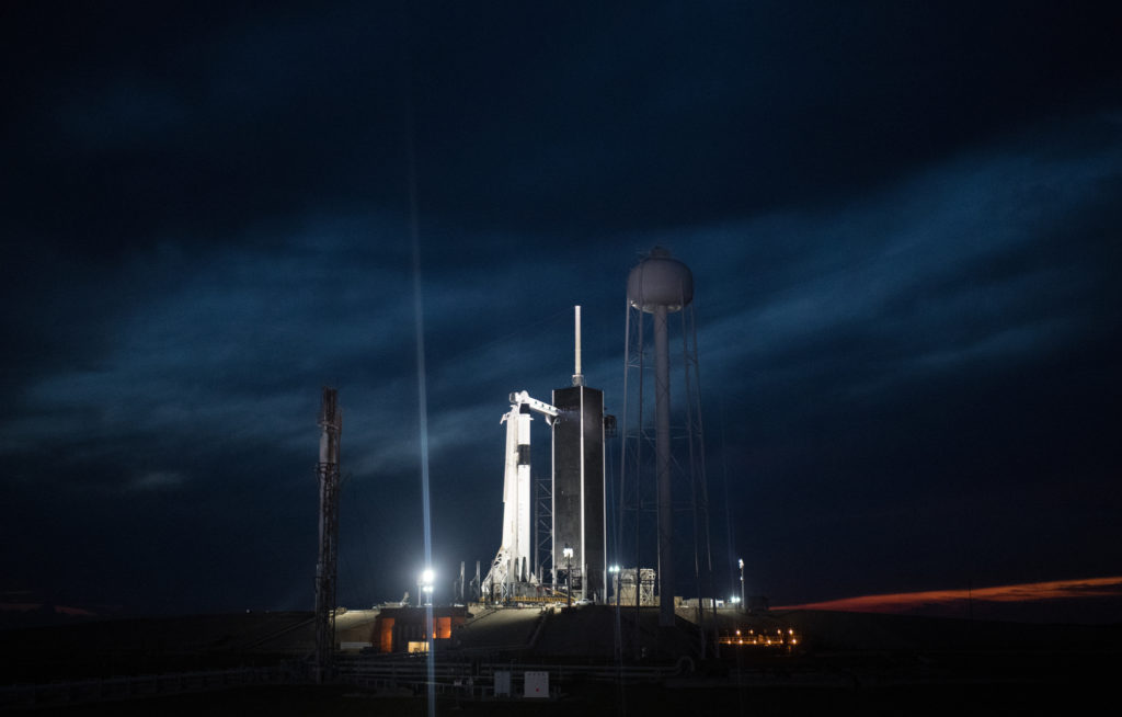 A SpaceX Falcon 9 rocket with the company's Crew Dragon spacecraft onboard is seen illuminated on the launch pad by spotlights at Launch Complex 39A as preparations continue for the Demo-1 mission, Friday, March 1, 2019, at the Kennedy Space Center in Florida.