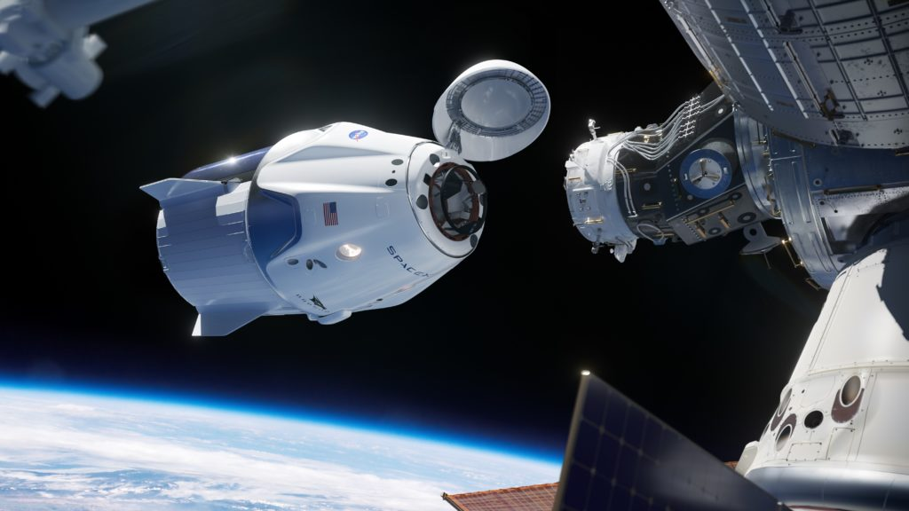 Artist illustration of SpaceX Crew Dragon docking to the International Space Station.