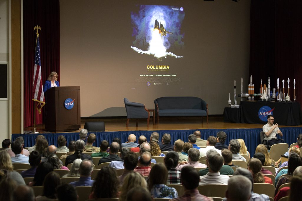 "Evelyn Husband Thompson, widow of STS-107 Commander Rick Husband, speaks to NASA civil service and contractor employees and guests in Kennedy Space Center's Training Auditorium on April 12, 2019. Husband Thompson was one of the presenters for ""Columbia: The Mission Continues,"" an event organized by the Apollo Challenger Columbia Lessons Learned Program (ACCLLP)."
