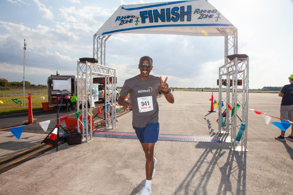 A participant crosses the finish line of Kennedy Space Center's annual Walk Run on March 26, 2019.