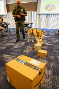 Fish and Wildlife Conservation Commission's (FWC) Port K9 Harry demonstrates how FWC is using specially trained dogs in airports, seaports, and mail facilities to detect illegal and invasive fish and wildlife species shipping into Florida.