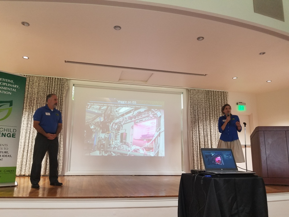 Trent Smith, left, and Gioia Massa give a talk on Veggie at the Student Research Symposium in Miami on April 27, 2019. Photo credit: NASA/Dinah Dimapilis