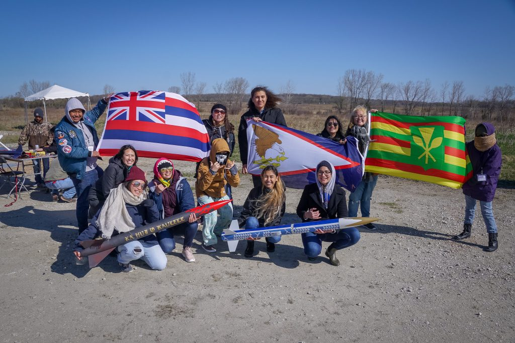 Students show off their rockets at the 10th annual First Nations Launch on April 26, 2019.