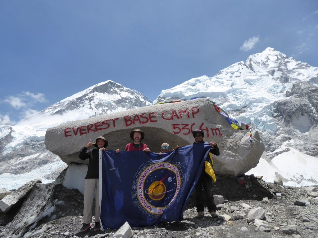 "Hintze wrote, ""The NASA Gateway flag has made it to Everest Basecamp! That's @OceanDebra, me, Bhalakaji our porter, and Dambar our guide!"""