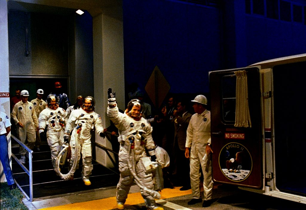 The crewmen of the Apollo 11 lunar landing mission leave the Kennedy Space Center's Manned Spacecraft Operations Building (MSOB) during the prelaunch countdown on July 16, 1969.