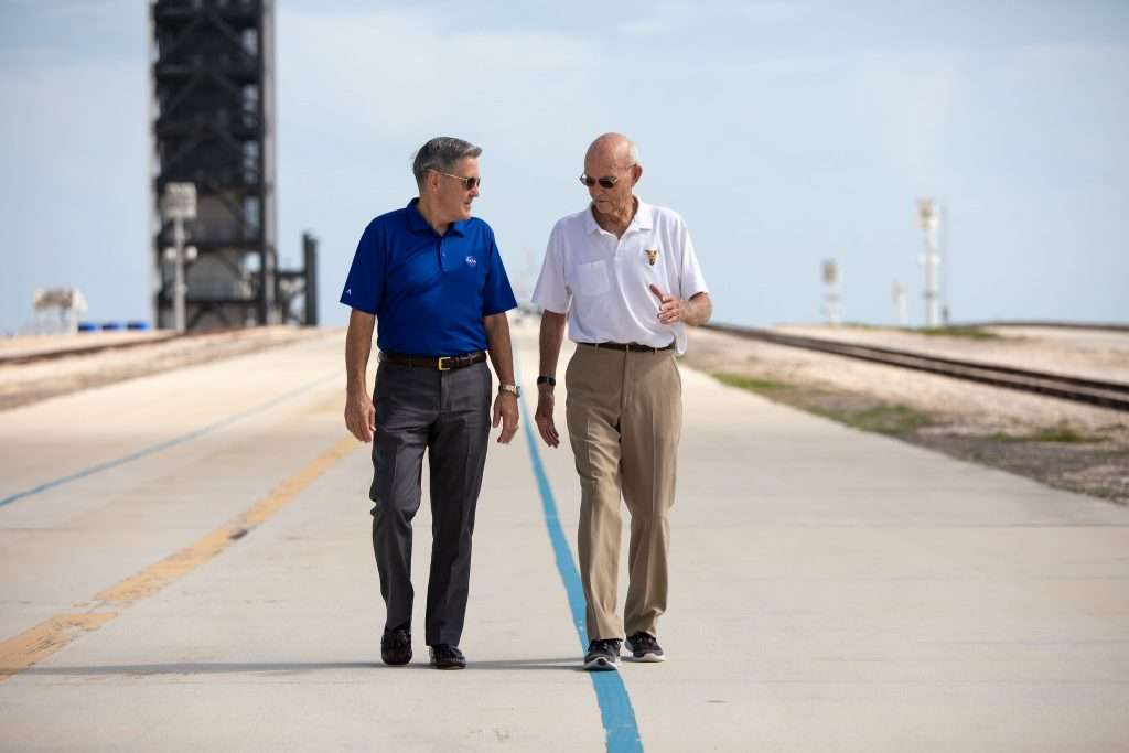 Kennedy Space Center Director Bob Cabana talks with Apollo 11 astronaut Michael Collins during his visit to Launch Complex 39A, site of the launch of the Apollo 11 launch to the Moon.