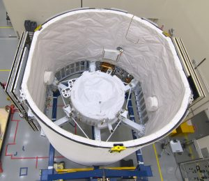 "The International Docking Adapter 3, a critical component for future crewed missions to the International Space Station, is carefully packed away in the unpressurized ""trunk"" section of the SpaceX Dragon spacecraft at the SpaceX facility on Cape Canaveral Air Force Station in Florida on June 19."