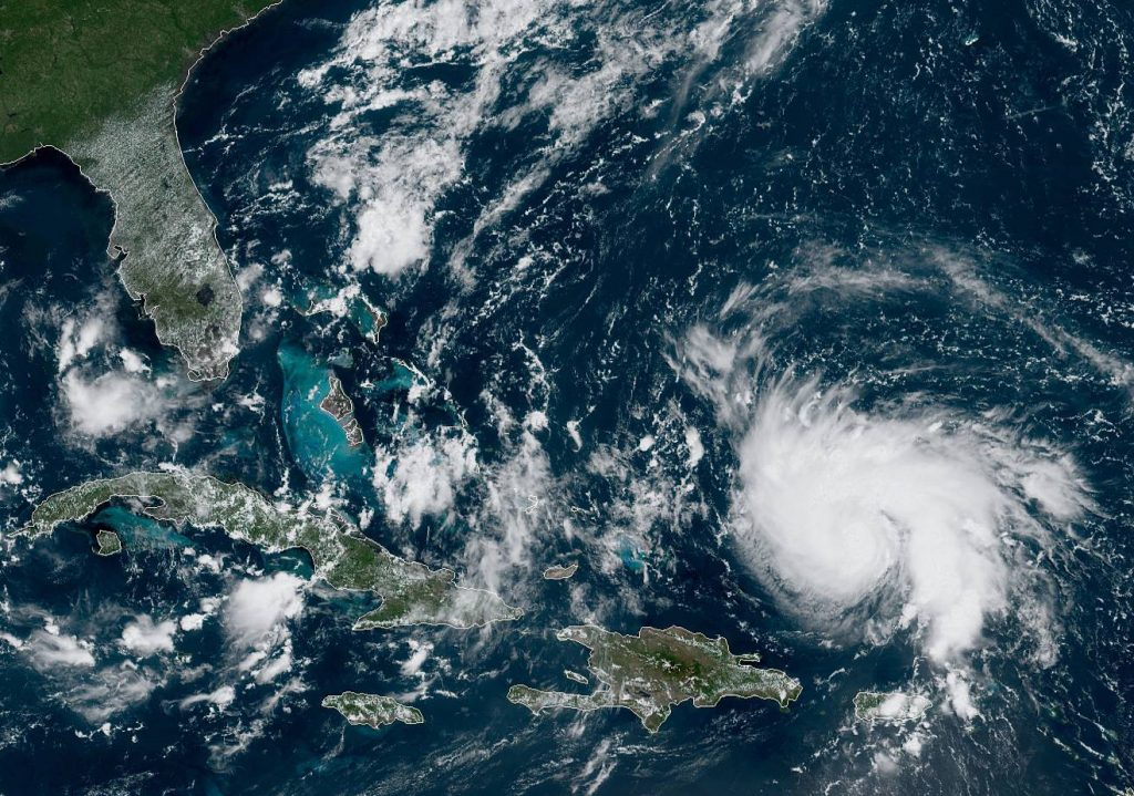 Hurricane Dorian, right, as viewed from the GOES-East satellite on Thursday, Aug. 29, 2019.