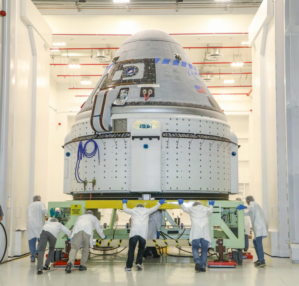 The CST-100 Starliner spacecraft to be flown on Boeing's Orbital Flight Test (OFT) is viewed Nov. 2, 2019, while undergoing launch preparations inside the Commercial Crew and Cargo Processing Facility at Kennedy Space Center in Florida