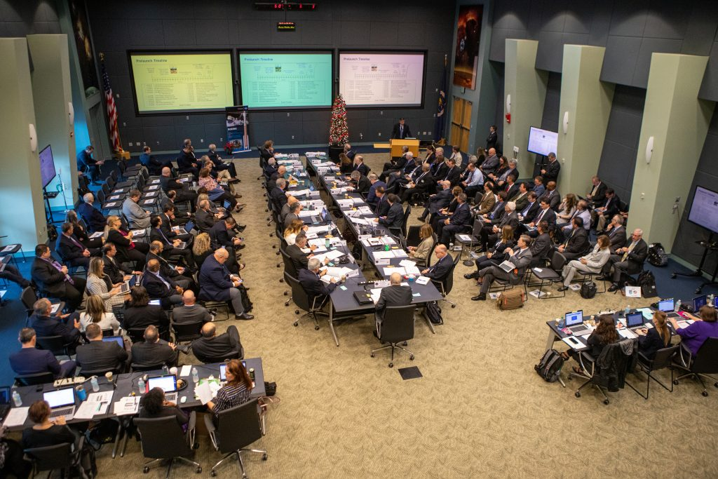 NASA and Boeing managers take part in the flight readiness review for Boeing's upcoming Orbital Flight Test in Operations Support Building 2 at NASA's Kennedy Space Center in Florida, Dec. 12, 2019.
