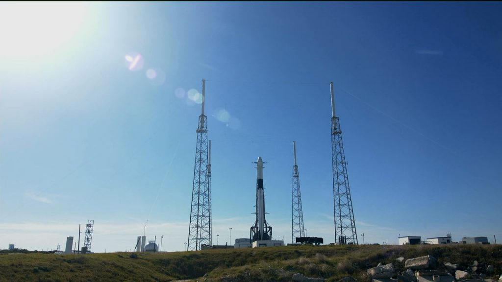 SpaceX Falcon 9 rocket and Dragon spacecraft await launch from Space Launch Complex 40.