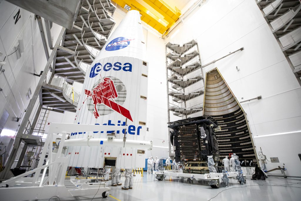 Both halves of a United Launch Alliance Atlas V payload fairing are positioned for installation around the Solar Orbiter spacecraft inside the Astrotech Space Operations facility in Titusville, Florida, on Jan. 20, 2020.