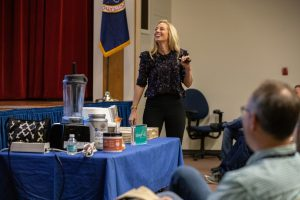 Carly Paige, an integrative nutrition health coach and chef, speaks to Kennedy Space Center employees inside the Florida spaceport's Training Auditorium on March 5, 2020, during the center's annual Safety and Health Days.