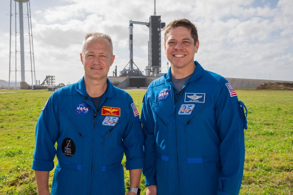 NASA astronauts Doug Hurley, left, and Bob Behnken stand near Launch Pad 39A at the agency's Kennedy Space Center in Florida on Jan. 17, 2020.