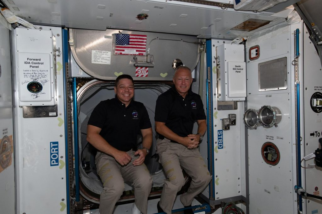NASA astronauts Bob Behnken, left, and Doug Hurley, are pictured having just entered the International Space Station on May 31, 2020, shortly after arriving aboard the SpaceX Crew Dragon spacecraft.