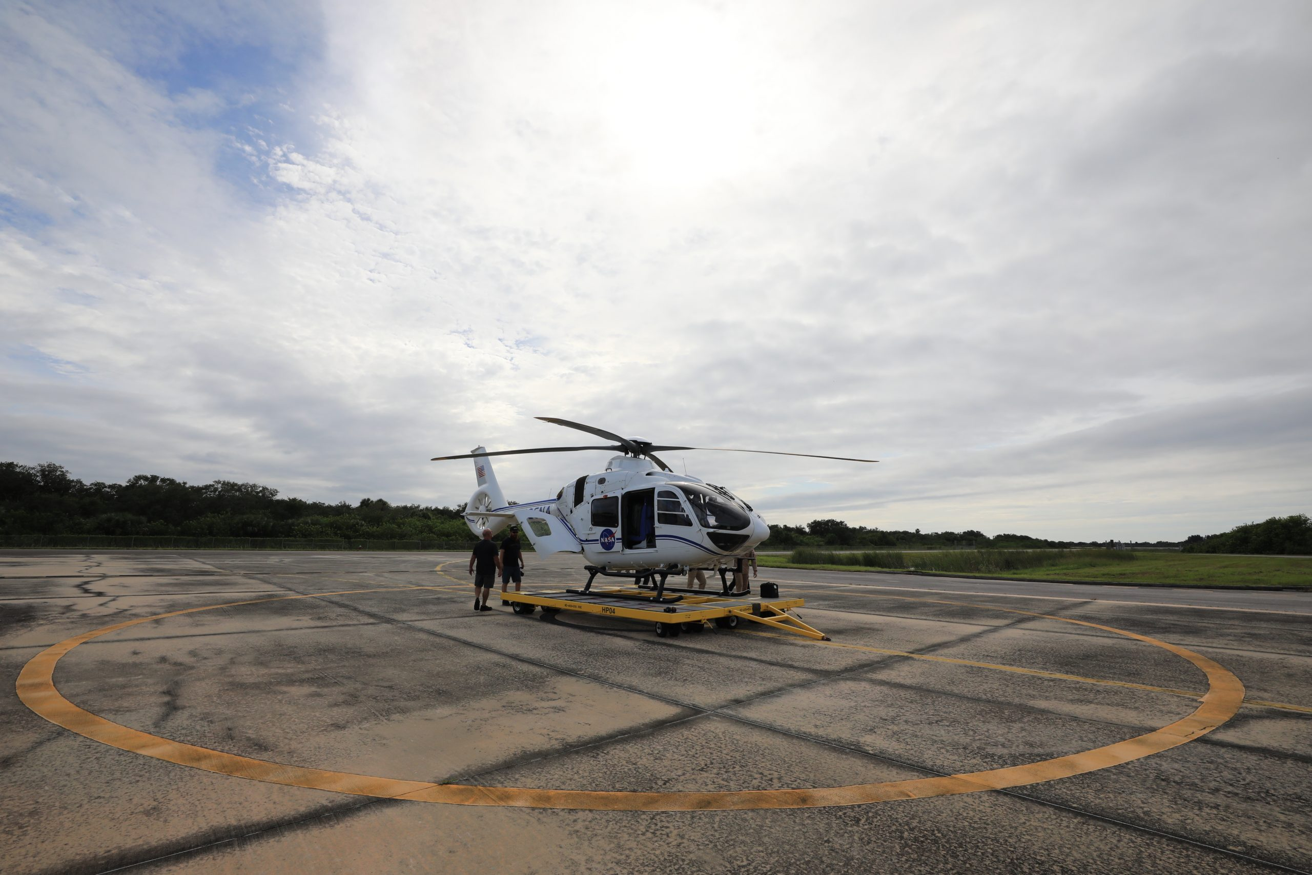 An Airbus H135 helicopter arrives at the Launch and Landing Facility runway at NASA's Kennedy Space Center in Florida on Sept. 30, 2020.