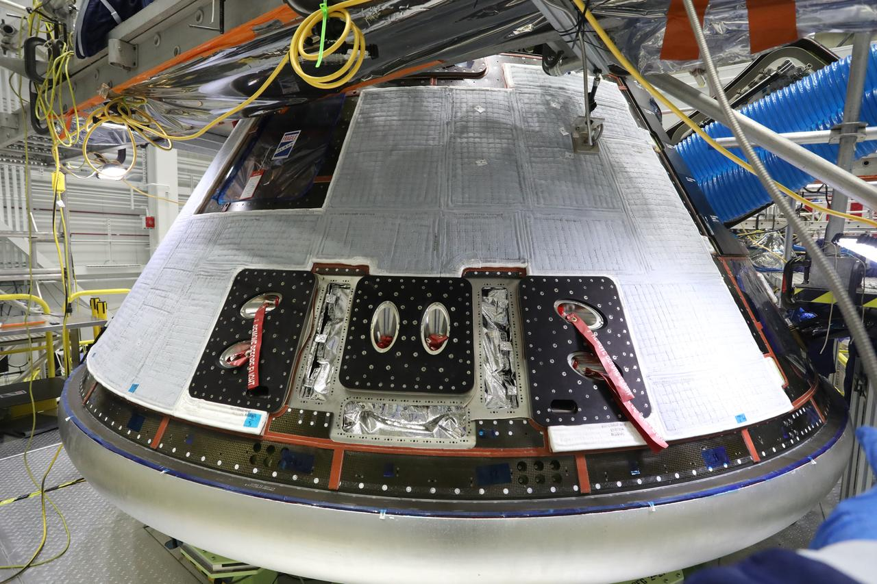 Boeing's Starliner crew module, with back shells installed, is inside the company's Commercial Crew and Cargo Processing Facility at Kennedy Space Center on December 8, 2020, in preparation for the Orbital Flight Test-2 (OFT-2). During the OFT-2 mission, the uncrewed Starliner spacecraft will fly to the International Space Station for NASA's Commercial Crew Program.