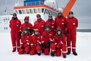 The 2021 overwintering team in front of Polarstern upon arrival in Antarctica.