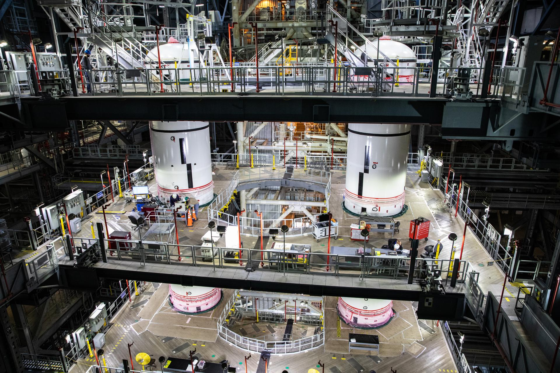 Space Launch System boosters for the Artemis I mission are stacked in the Vehicle Assembly Building.