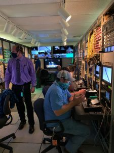 KSCTV personnel working inside master control during a NASA launch broadcast.