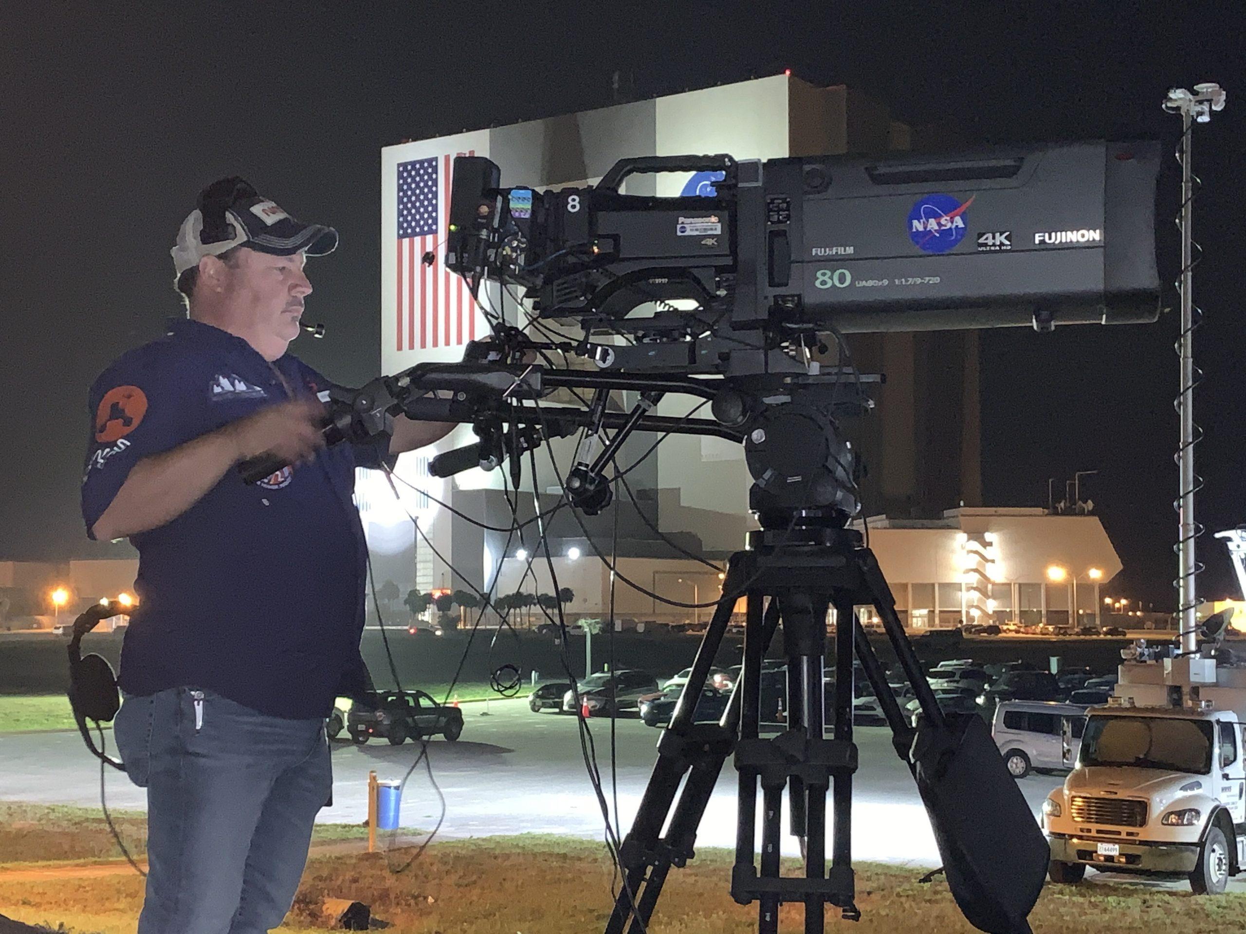 KSCTV personnel records a NASA launch broadcast at the NASA News Center.
