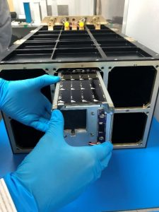 A Nanoracks employee performing the final integration of IT-SPINS into the E-NRCSD