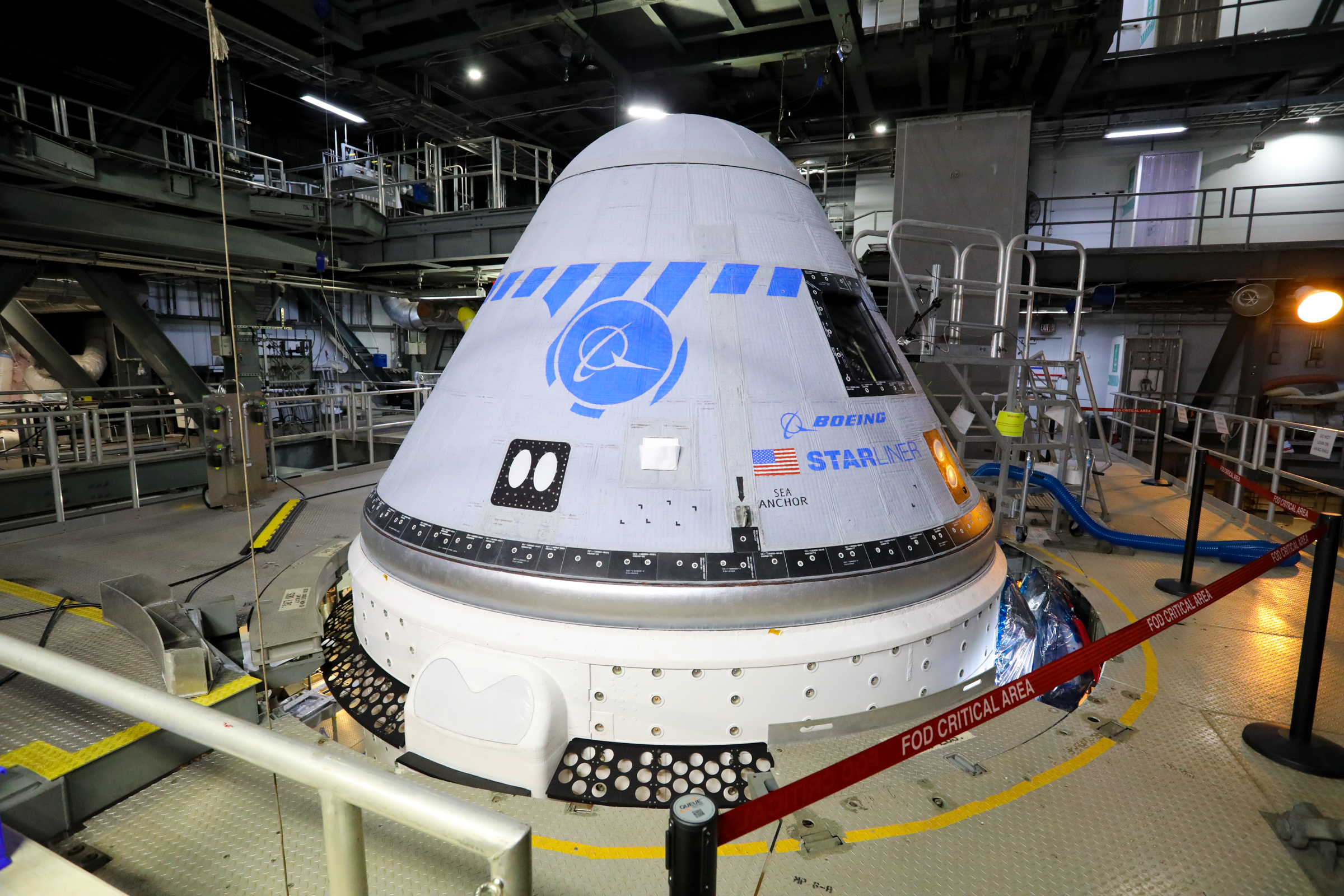 Boeing's CST-100 Starliner spacecraft is in view in the United Launch Alliance Vertical Integration Facility at Space Launch Complex 41 on Aug. 9, 2021.