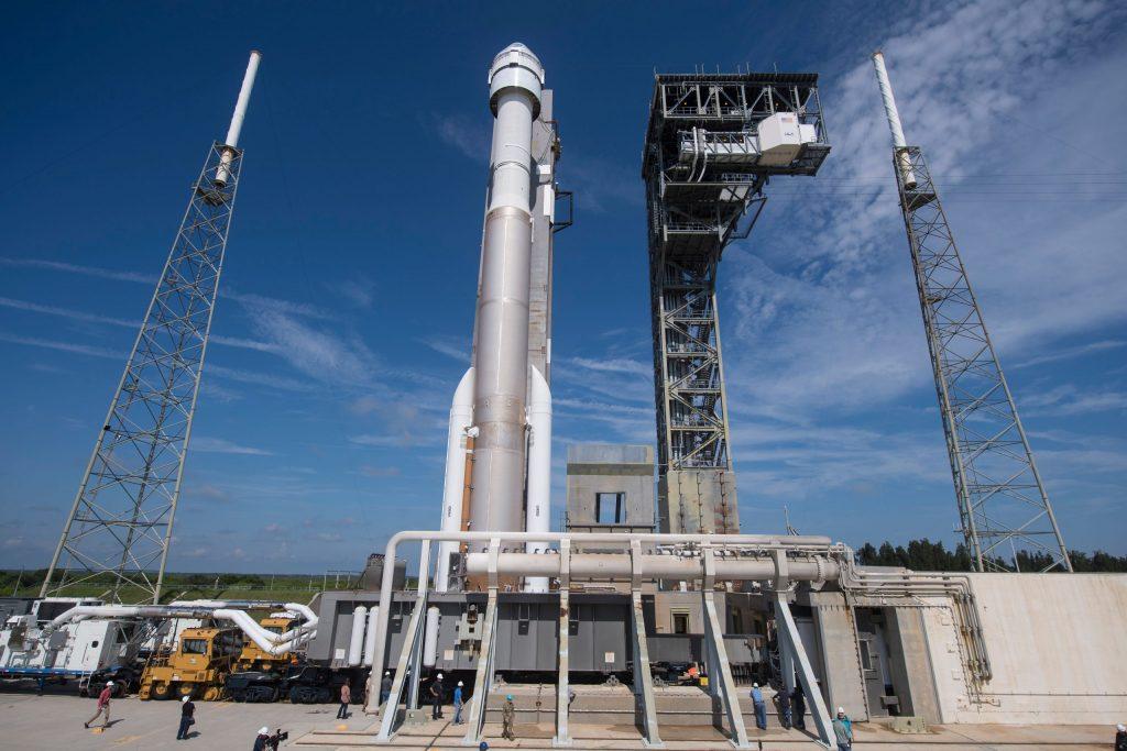 Atlas V rocket with Starliner on launch pad