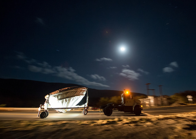 NASA's Low Density Supersonic Decelerator (LDSD) test vehicle is rolled out to the launch pad under moon light, Wednesday, June 3, 2015, at the U.S. Navy Pacific Missile Range Facility (PMRF) in Kauai, Hawaii. The LDSD crosscutting technology demonstration mission will test two breakthrough technologies that will enable larger payloads to be landed safely on the surface of Mars or other planetary bodies with atmospheres, including Earth. Photo Credit: (NASA/Bill Ingalls)