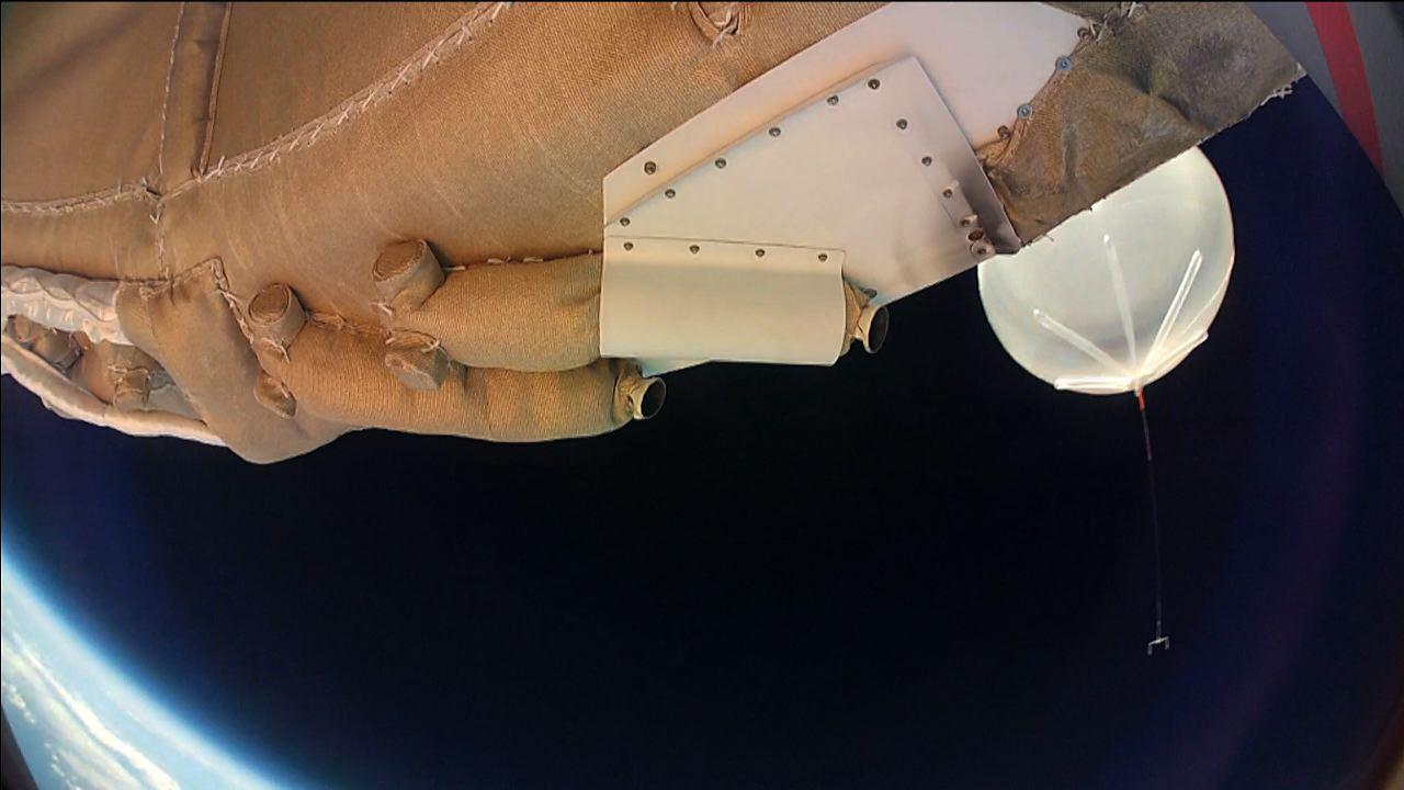Moments into its powered flight, the LDSD test vehicle captured this image of the balloon