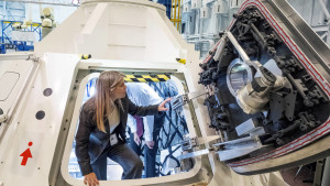 NASA Deputy Administrator Dr. Dava Newman explores a prototype Orion spacecraft. Photo credit: NASA