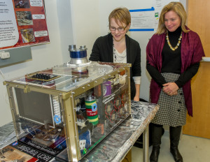 NASA Chief Scientist Dr. Ellen Stofan meets with Melissa Trainer in the SAM Testbed Lab during her visit to Goddard Space Flight Center