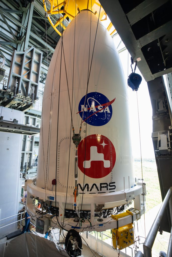 The United Launch Alliance (ULA) payload fairing with NASA's Mars 2020 Perseverance rover secured inside is positioned on top of the ULA Atlas V rocket inside the Vertical Integration Facility (VIF) at Space Launch Complex 41 at Cape Canaveral Air Force Station in Florida on July 7, 2020.