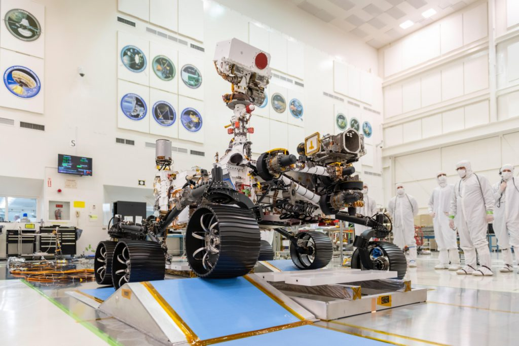 Engineers observe the first driving test for NASA's Mars 2020 Perseverance rover in a clean room at NASA's Jet Propulsion Laboratory in Pasadena, California, on Dec. 17, 2019.