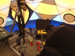 Alex Wong from Honeybee Robotics sets up the Icebreaker-2 drill inside a dome tent on Drill Hill.