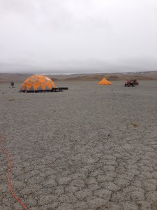"The Icebreaker team's drill test camp, set up in August 2013 at ""Drill Hill"", a massive impact breccia deposit within Haughton Crater."