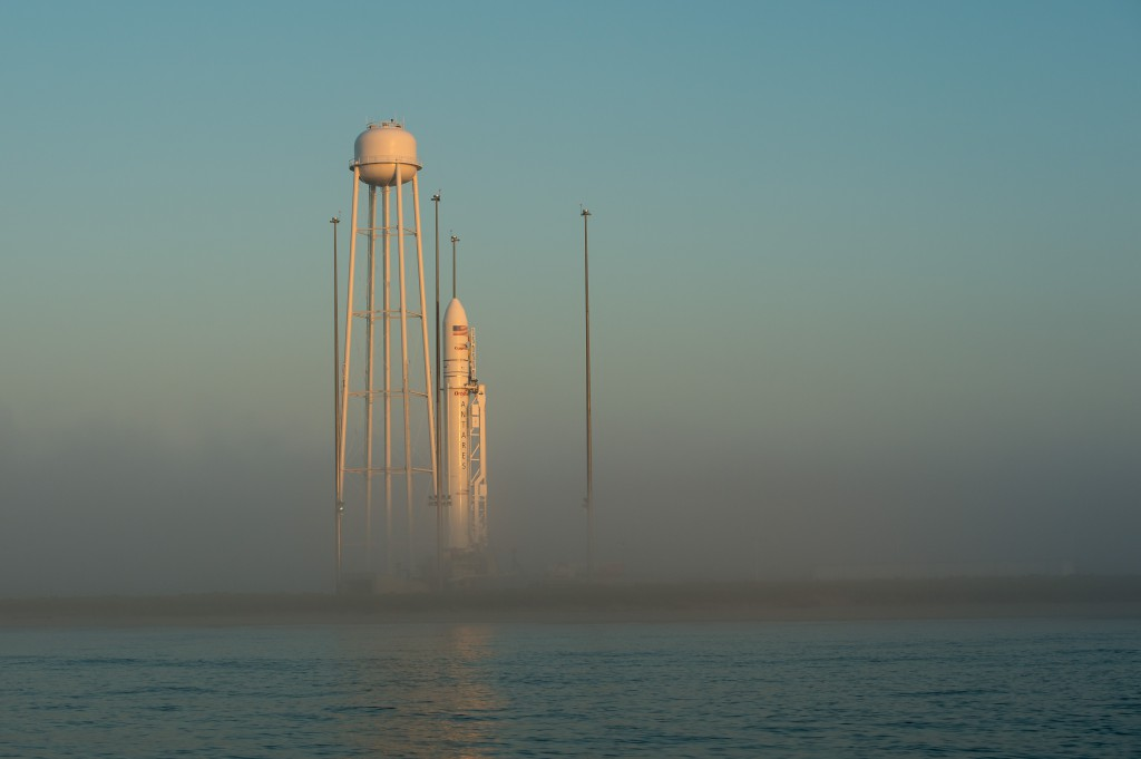 The Orbital Sciences Corporation Antares rocket, with the Cygnus spacecraft aboard, is seen during sunrise, Saturday, July 12, 2014. Credit: NASA/Bill Ingalls