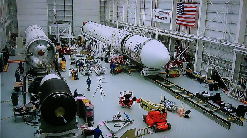 This view inside the HIF shows Orb-2's Antares rocket (right) prior to roll out to the launch pad on July 10, 2014. The first (white) and second (black) stages of Orb-3's Antares are at the left side of the image. Credit: NASA Wallops