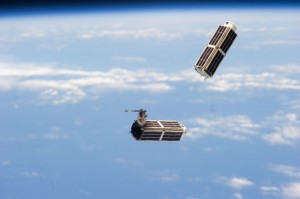 The small Planet Labs satellites included in Cygnus' cargo are similar to those pictured here, part of a constellation launched into orbit earlier this year from the International Space Station. Credit: NASA