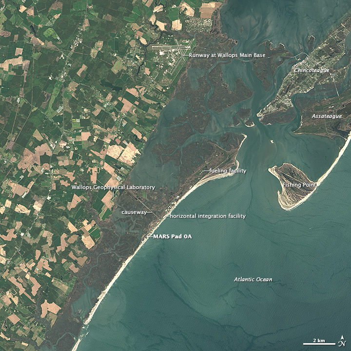 This view of NASA's Wallops Flight Facility along Virginia's Eastern Shore comes from the Landsat 8 satellite. Credit: NASA's Earth Observatory; image by Jesse Allen and Robert Simmon, using data provided by the U.S. Geological Survey.