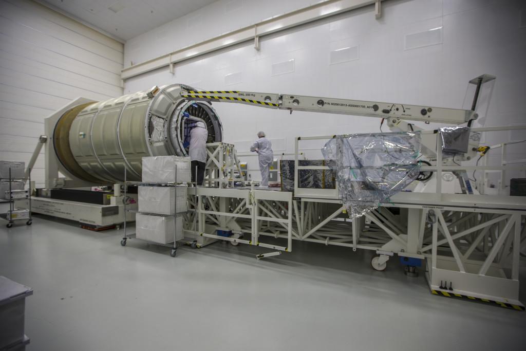 Orbital ATK technicians load Cygnus
