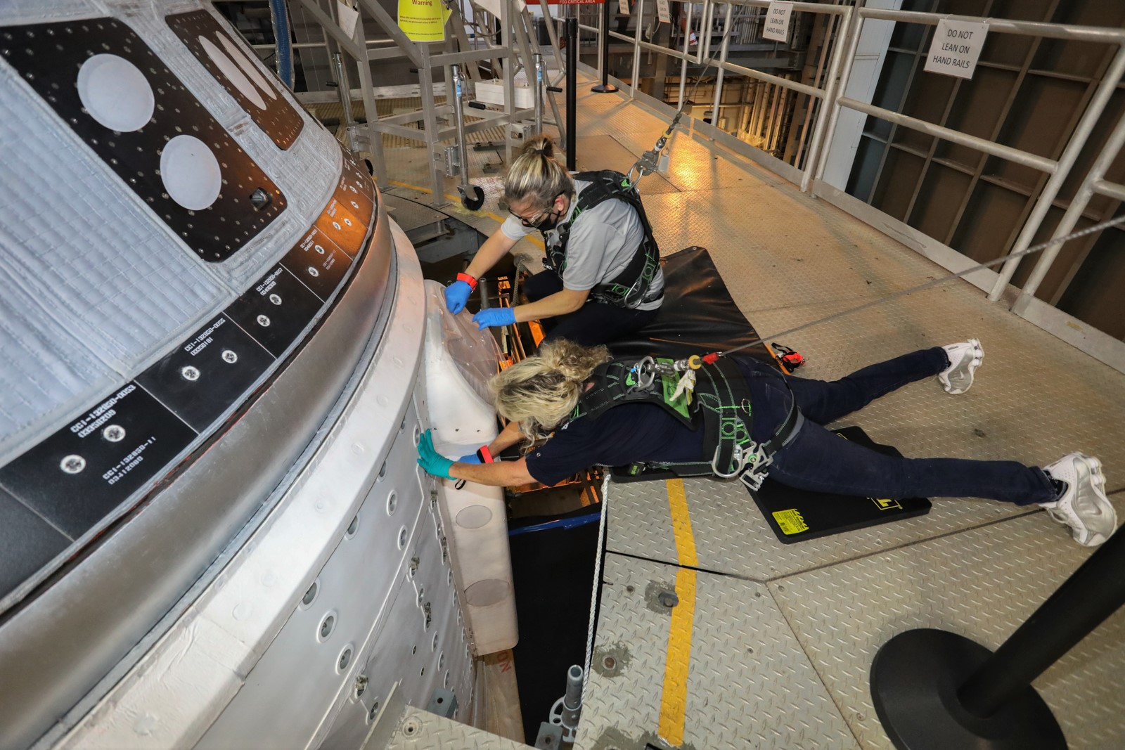 Boeing engineers continue work at the United Launch Alliance Vertical Integration Facility on the Starliner propulsion system valves.