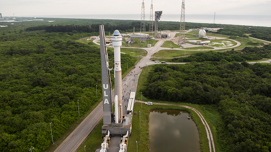 Boeing's CST-100 Starliner spacecraft atop the United Launch Alliance Atlas V rocket rolls out to the launch pad on Monday at Cape Canaveral Space Force Station in Florida.