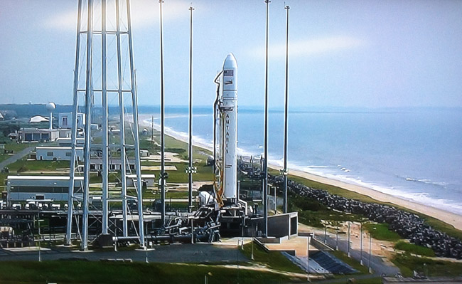 The Antares rocket with Cygnus spacecraft aboard stands on its launch pad, July 13, 2014. Credit: NASA