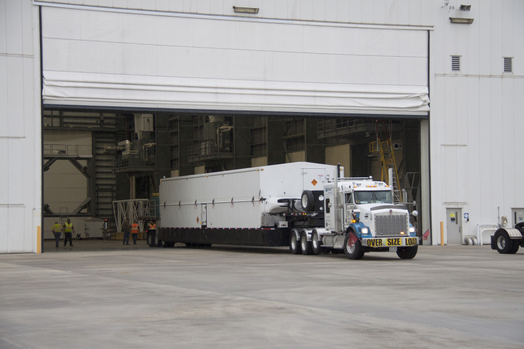 A truck delivers the United Launch Alliance Centaur upper stage to the Horizontal Integration Facility